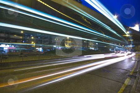 Modern Urban City with Freeway Traffic at Night stock photo, Modern Urban City with Freeway Traffic at Night, hong kong by Keng po Leung