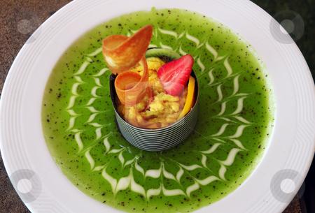 Fruit dessert stock photo, Fruit dessert with green kiwi sauce on white plate by Tomas Hajek