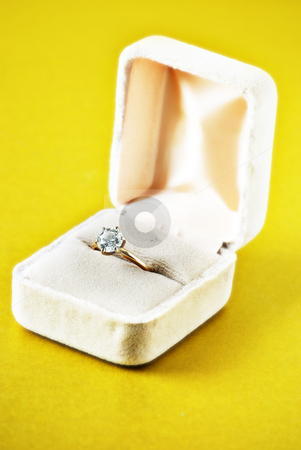 Diamond ring stock photo, Diamond engagement ring on gold background by HD Connelly