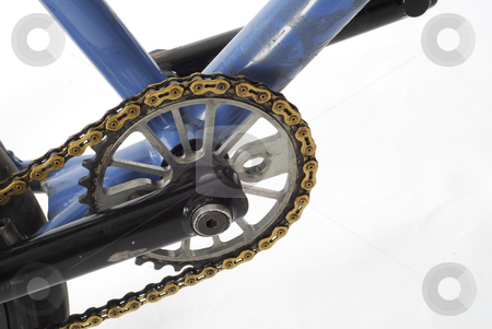 Bicycle sprocket stock photo, Worn dirty bmx bicycle sprocket isolated on white background by John McAllister
