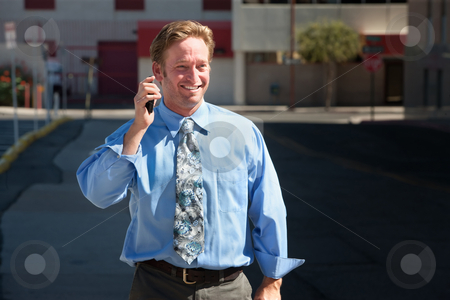Pleased, good-looking guy talks on cell phone. stock photo, Handsome man is happy with his phone call. by Scott Griessel