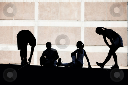 Men and women runners stretching. stock photo, Group of runners stretching before race. by Scott Griessel