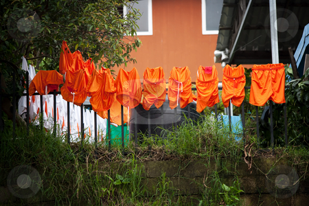 Soccer uniforms drying on the line in Costa Rica stock photo, Orange soccer uniforms drying on the line in Costa Rica by Scott Griessel