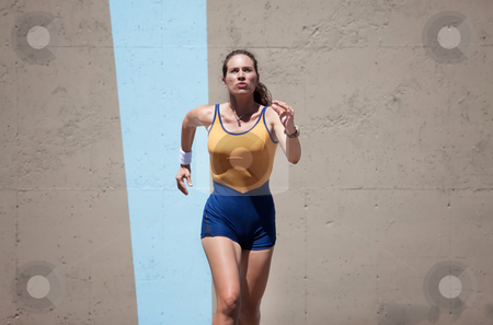 Pretty, focused woman runs to keep in shape. stock photo, Determined woman runs for a healthy lifestyle. by Scott Griessel