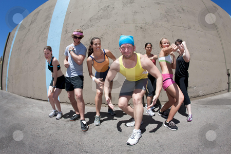 Athletes Posing stock photo, Attractive young athletes posing and flexing their muscles by Scott Griessel