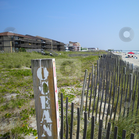 Ocean sign stock photo, A sign at the beach showning the end of road by Tim Markley