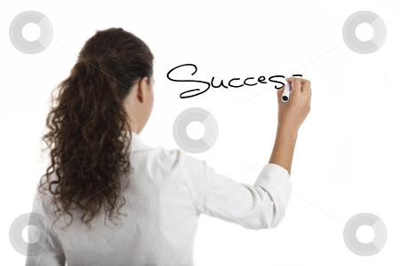 Drawing the word Sucess stock photo, Young businesswoman drawing the word sucess, isolated on white background by ikostudio