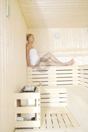 Spa and wellness treatment at sauna stock photo, Beauty spa and wellnes body treatment with young woman at  wooden sauna by Benis Arapovic
