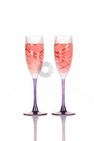 Two festive glasses with rose wine stock photo,  by Hector Arencibia