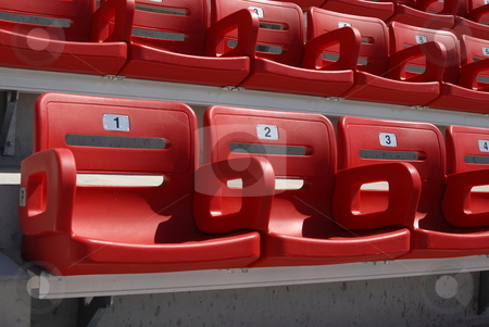 Stadium Seats stock photo, Red stadium seats beginning with the numbers 1,2,3, by Bob Helvey
