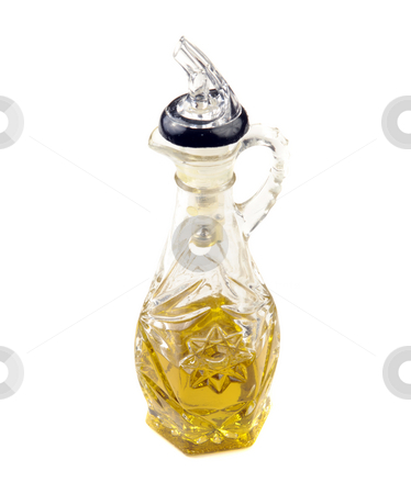Olive Oil stock photo, A glass container filled with olive oil, isolated against a white background by Richard Nelson