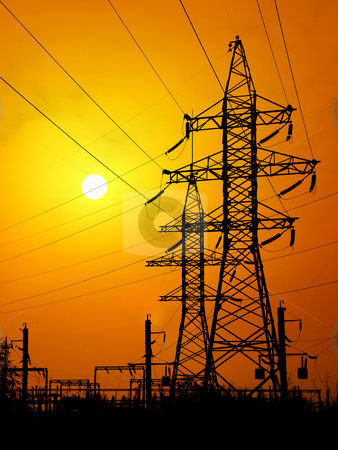 Energy towers. stock photo, Energy towers on sunset background. by Oleksiy Fedorov