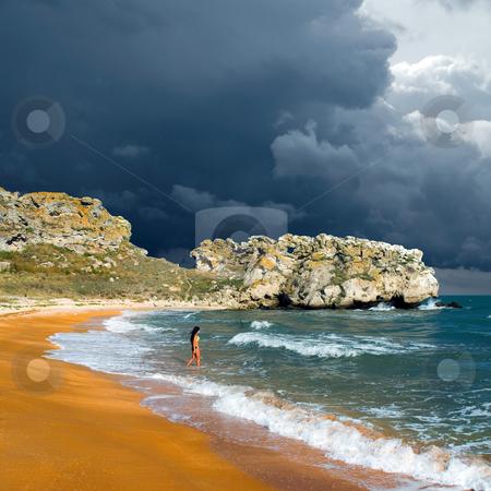 Girl on beach. stock photo, Longhaired pretty girl on sandy beach. by Oleksiy Fedorov