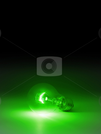Lightbulb. stock photo, Lightbulb on black background with space for text. by Oleksiy Fedorov