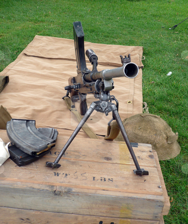 World war two machine gun stock photo, World war two british machine gun set up on a vintage box by Michael Travers
