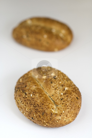 Cereal buns stock photo, Two small baked cereal bun on white photo, shallow depth of view by Robert Remen
