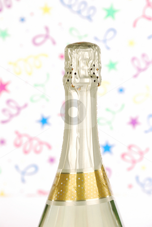 Champagne bottle top with confetti background stock photo, Champagne bottle top with confetti background by Hector Arencibia