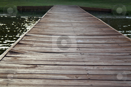 Wooden Dock stock photo, An old wooden dock heading off in the distance by Kevin Tietz
