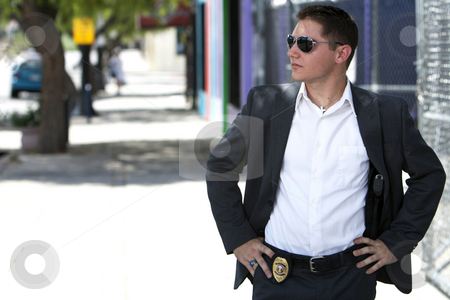 Undercover male officer in a suit stock photo, Male undercover officer dressed in a suit with his badge and gun showing looking away by Joe Hubbard