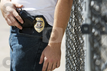 Pistol and badge stock photo, Private Investigator with badge and a 38 pistol. by Joe Hubbard