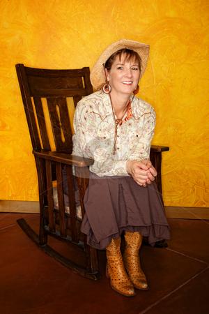 Pretty Western Woman  stock photo, Pretty western woman in antique rocking chair by Scott Griessel