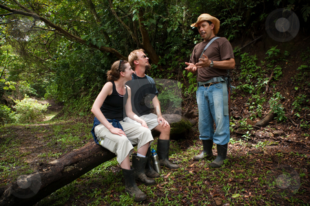European and American couple with nature guide stock photo, Couple with nature guide in Costa Rican cloud forest by Scott Griessel