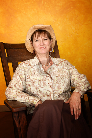 Pretty Western Woman  stock photo, Pretty western woman in antique rocking chair by Scott Griessel