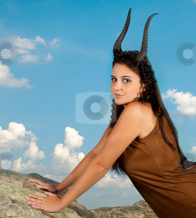 Capricorn on a rock stock photo, Capricorn or Goat woman, this photo is part of a series of twelve Zodiac signs of astrology by Anneke
