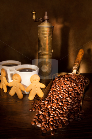Coffee still-life stock photo, Antique coffee grinder with steaming coffee, cookies and books by Anneke