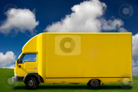 Yellow truck stock photo, Yellow truck on a beautiful green meadow with copy space for text by ikostudio