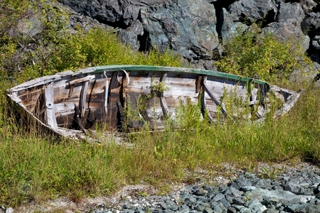 Abandoned vessel. stock photo, Old abandoned rowboat with rudder. by Svein Hovland