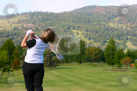 Female Golfer stock photo, Blond female golfer following her shot from the tee-box down the fairway by Vanessa Van Rensburg