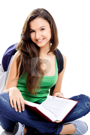 Happy female student stock photo, Beautiful young female student sitting on floor studying, isolated on white by ikostudio