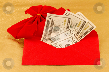 Cash, The Holiday Gift of Choice stock photo, Cash gift of dollars is in red envelope with red velvet bow accent against gold paper to show the holiday gift of choice, especially during hard economic times; by Florence McGinn