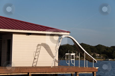 Water Slide stock photo, A waterslide on the end of a wooden dock by Kevin Tietz