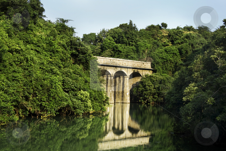 Ancient roman bridge stock photo, Ancient roman bridge in the forest on the lake by Keng po Leung