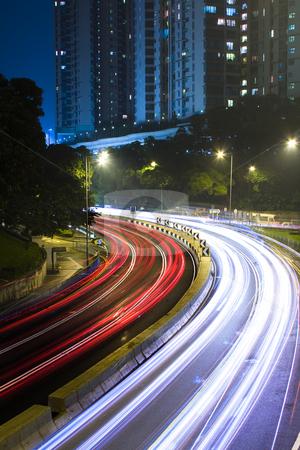 Traffic in city at night in hong kong stock photo, Traffic in city at night in hong kong. by Keng po Leung