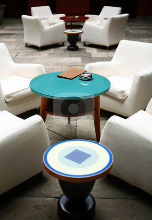 Cafe interior stock photo, Cafe indoor with white sofas and blue glass small table by Tomas Hajek