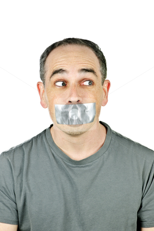 Man with duct tape on mouth stock photo, Portrait of man with duct tape over his mouth glancing sideways by Elena Elisseeva