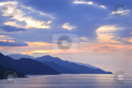 Tropical Mexican coast at sunset stock photo, Sunset over mountains on Pacific coast near Puerto Vallarta, Mexico by Elena Elisseeva