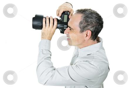 Photographer with camera stock photo, Portrait of male photographer with camera isolated on white background by Elena Elisseeva