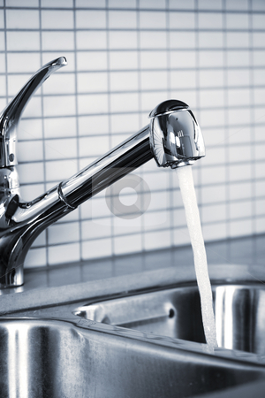 Kitchen faucet stock photo, Stainless steel kitchen faucet and sink with running water by Elena Elisseeva