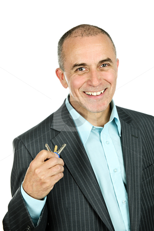 Man holding keys stock photo, Portrait of smiling businessman holding keys isolated on white background by Elena Elisseeva