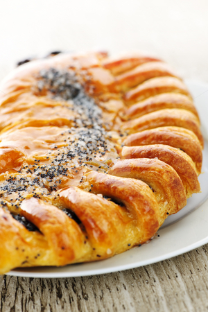 Poppy seed strudel stock photo, Closeup of poppy seed strudel dessert pastry by Elena Elisseeva
