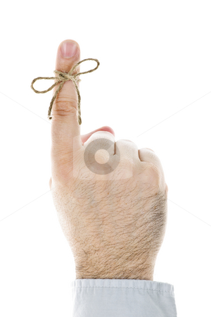 String tied on finger as reminder stock photo, String tied on finger as reminder isolated on white background by Elena Elisseeva