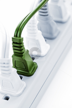 Wires plugged into power bar stock photo, Many plugs plugged into electric power bar by Elena Elisseeva