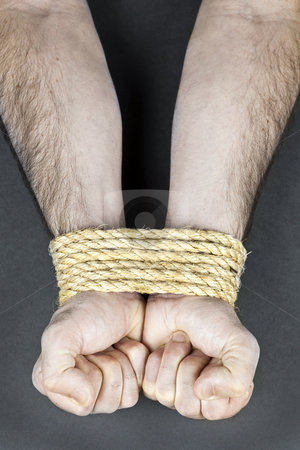 Wrists tied with rope stock photo, Male hands tied up with strong rope by Elena Elisseeva