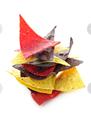 Tortilla chips stock photo, Stack of colorful tortilla chips isolated on white background by Elena Elisseeva