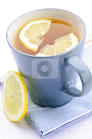 Tea with lemon stock photo, Cup of fresh hot tea with lemon slices by Elena Elisseeva