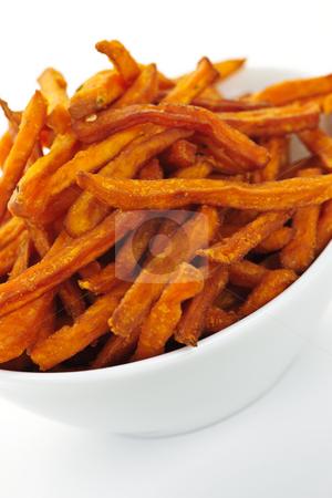 Sweet potato fries stock photo, Closeup of sweet potato or yam fries in white bowl by Elena Elisseeva